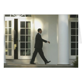 President Barack in deep thought as he walks Card