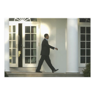 President Barack in deep thought as he walks Photo Print