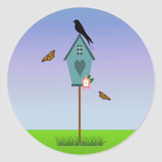 Pretty Bird Silhouette on top a Blue Birdhouse Classic Round Sticker