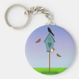 Pretty Bird Silhouette on top a Blue Birdhouse Keychain