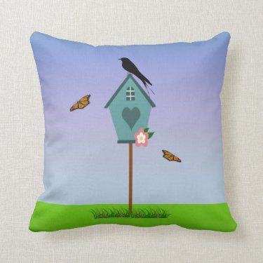 Pretty Bird Silhouette on top a Blue Birdhouse Throw Pillows