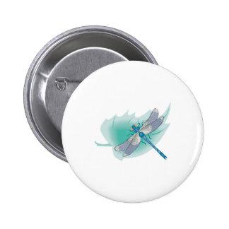 pretty blue dragonfly on leaf button