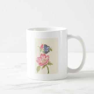 Pretty butterfly on pink flower coffee mug