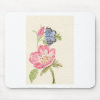 Pretty butterfly on pink flower mouse pad