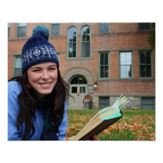 Pretty college student studying in autumn leaves poster