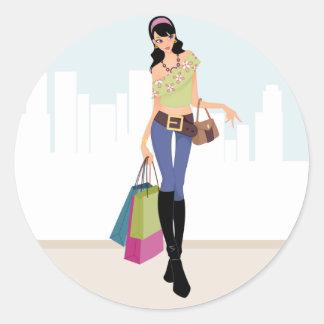 Pretty girls shopping in the city classic round sticker