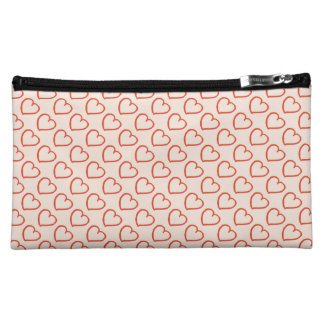 Pretty hearts pattern red on pink makeup bag