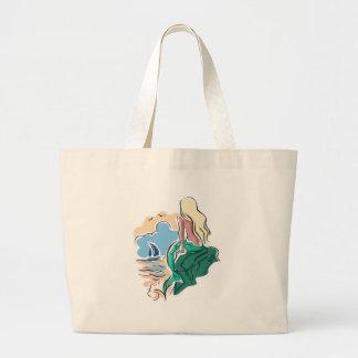 pretty mermaid sitting on rock bags