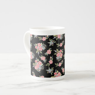 Pretty pink flower pattern on black tea cup