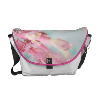 Pretty pink flower with blue and green on bag