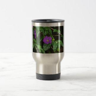 Pretty purple flower against dark background travel mug