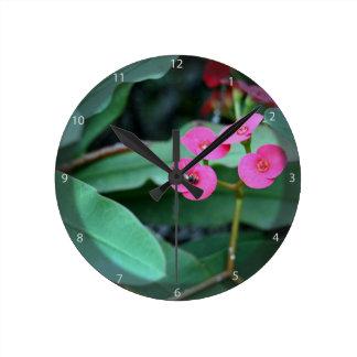 Pretty tiny pink flowers round clocks