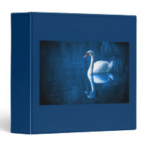 Pretty white swan floating on a blue lake binder
