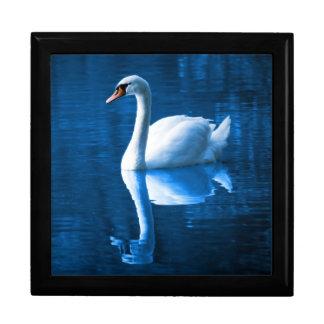 Pretty white swan floating on a blue lake trinket boxes
