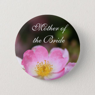 Pretty wild pink rose flower button for weddings.