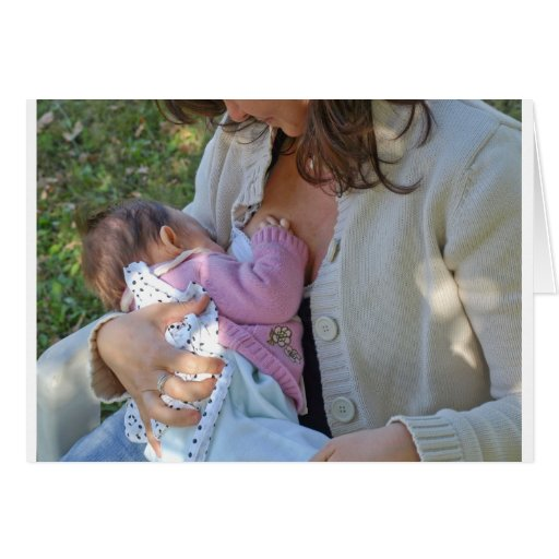 Pretty young brunette mum breastfeeding her baby greeting card