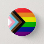 """Pride Flag Reboot - trans and POC inclusive Button<br><div class=""""desc"""">It's a twist on the traditional rainbow flag,  created by artist Daniel Quasar,  that includes black and brown stripes for people of color and the colors of the trans flag in an arrow to indicate progress.</div>"""
