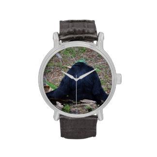 primate del animal que se sienta trasero reloj de mano