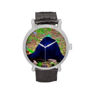 primate del animal trasero del verde azul relojes