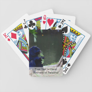 Primate eating greens on edge of land blue bicycle playing cards