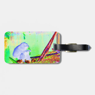 Primate eating greens on edge of land neon invert. bag tag