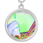 Primate eating greens on edge of land neon invert. necklace