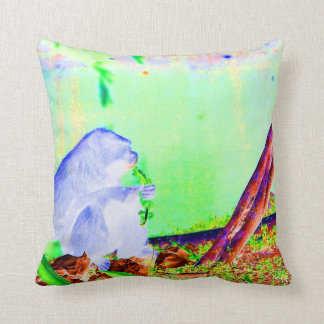 Primate eating greens on edge of land neon invert. throw pillow
