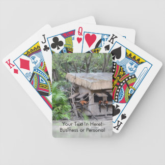 primates on tiki style monkey hut at zoo bicycle playing cards