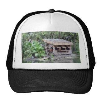 primates on tiki style monkey hut at zoo trucker hat