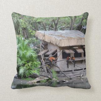 primates on tiki style monkey hut at zoo throw pillow