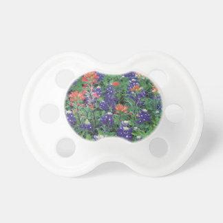 Primavera de la púrpura de la flor de la primavera chupetes de bebé