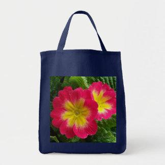 Primaveras amarillas del rojo cereza bolsas de mano