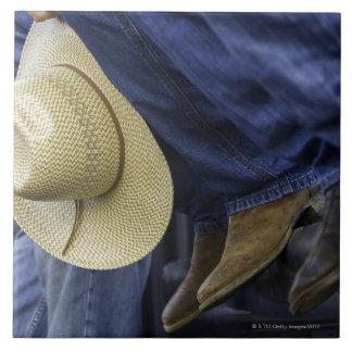 Primer de botas y del gorra azulejo cuadrado grande