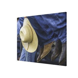Primer de botas y del gorra impresiones en lona estiradas