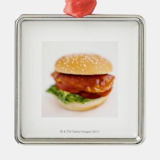 Primer de la hamburguesa del pollo adorno navideño cuadrado de metal