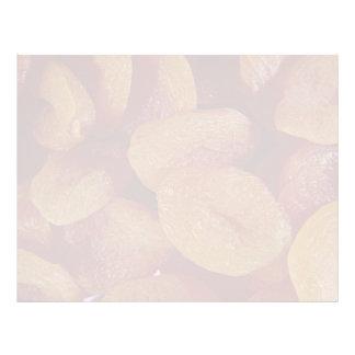 Primer de la textura de los albaricoques secados plantilla de membrete