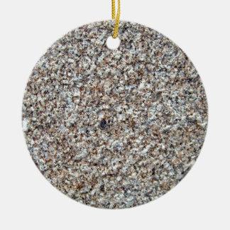 Primer de la textura del fondo del granito adorno de navidad