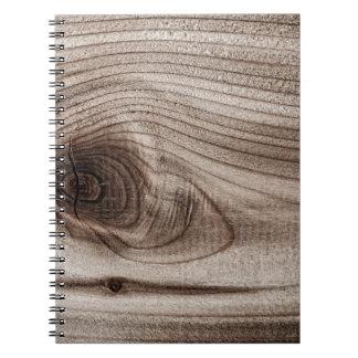 Primer de madera con el nudo cuadernos