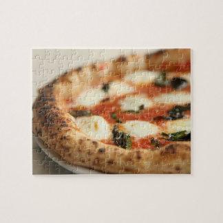 Primer de una empanada de pizza entera puzzles