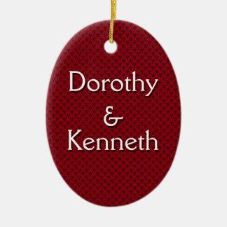 Primer ornamento del navidad en el modelo rojo de adorno navideño ovalado de cerámica