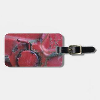 Primer oxidado rojo del camión etiqueta de maleta
