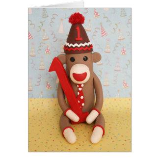 Primera celebración del mono del calcetín del tarjeta de felicitación