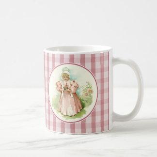 Primera Pascua del bebé. Taza del regalo de Pascua