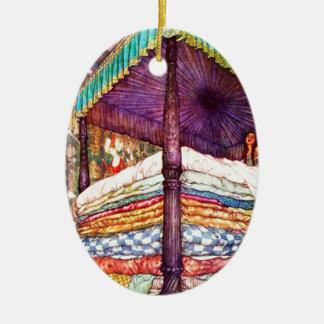 Princesa y el guisante adorno navideño ovalado de cerámica