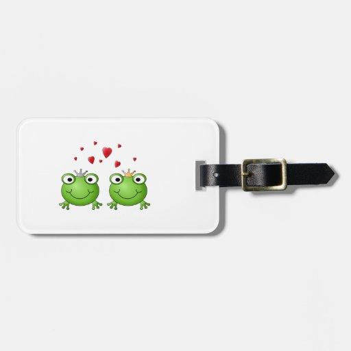 Príncipe de la rana y princesa de la rana, con los etiqueta de equipaje