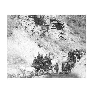 Procession of Stagecoaches Coming down Mountain Canvas Print