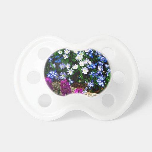 Productos púrpuras y blancos azules del diseño flo chupete de bebe