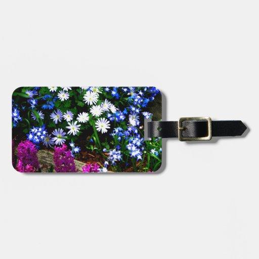 Productos púrpuras y blancos azules del diseño flo etiquetas bolsa