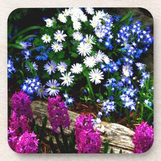 Productos púrpuras y blancos azules del diseño flo posavaso