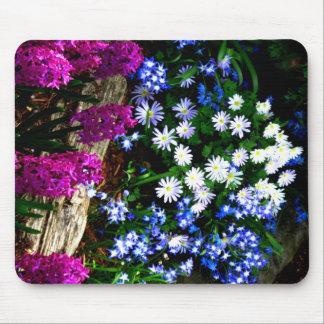 Productos púrpuras y blancos azules del diseño flo tapetes de ratones